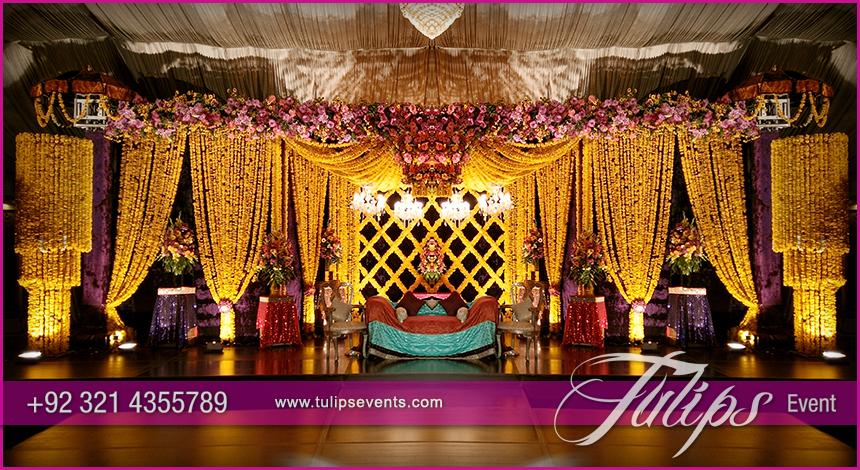 Yellow drape mehndi stage tulips event management for Mehndi decoration