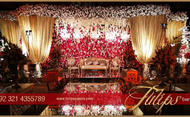 Red Gold Pakistani Baraat Stage Floral Backdrop Ideas In