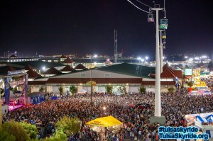 Tulsa Skyride at night: Soaring over the show and the crowd.