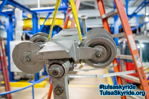 Tulsa Skyride going up: a VR 101 grip and hanger are being hoisted up to the station track.