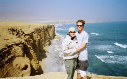 Couple Standing on the edge of Paracas Cliff, Peru