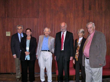 The symposium speakers gather with Garniss Curtis, who performed radiometric dating on Olduvai Gorge. (L to R: Yoel Rak, Marta Lahr, Garniss Curtis, Frank Brown, Meave Leakey, Richard Leakey). Photo credit: Steve Boles.