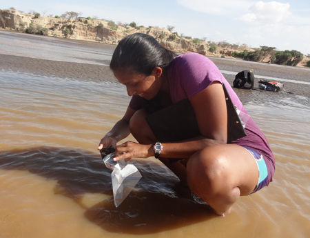 GEO303 – Vaishnavi samples sediment from the Turkwel River.