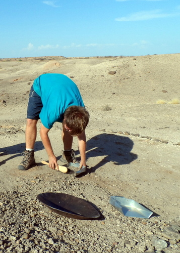 Patrick collects the sediment for sieving