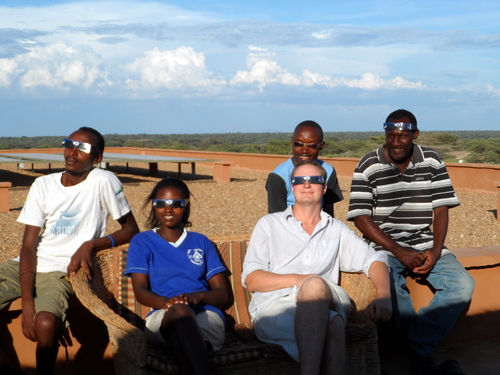 Derrick, Lucy, Tom, Timothy and Nyete watching the eclipse