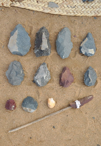 """Some of the tools produced by the students. The top two rows are Acheulean handaxes, and on the last row we have a rhyolite chopping tool, a phonolite retouched flake, a quartz chopping tool, and a retouched rhyolite """"flake-blade""""."""