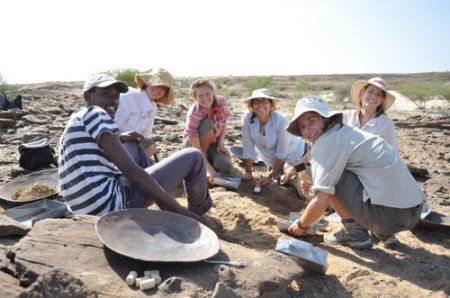 Abdi, Robyn, Kailie, Angela, Erica and Sarah pose for a picture as the excavate the bone.