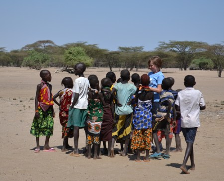 Lucy shows a group of primary school students a picture she took of them.
