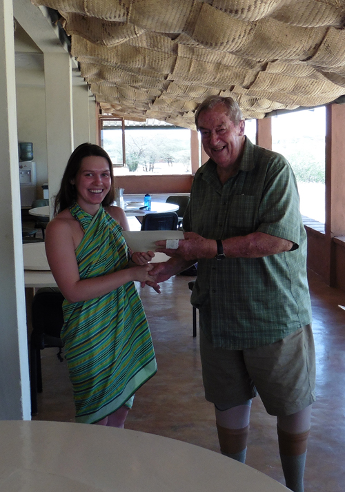 Alex receives her certificate from Dr Leakey