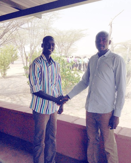 TBI community program coordinator, Peter Akol (left), shakes hands with the chairman of the TBI bursary committee, Mr Paul Igwar (right). Both were very happy to finally have a TBI student visit.