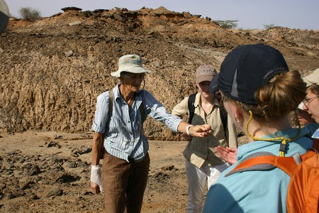 Dr. Leakey shows students a fossilized tooth of another type of crocodile.