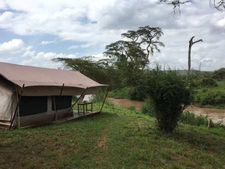 One of the tents we are staying in at River Camp (note there is an electric fence that surrounds the camp).