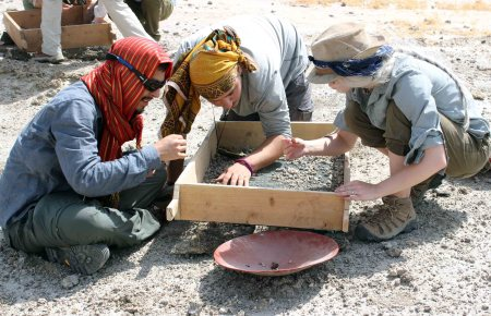 Students pick through what is left over in the sieve to find smaller fragments of fossils that were missed on the first pass.