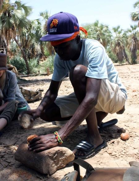 John Ekusi demonstrates the palm nut processing.
