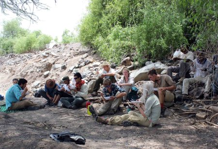 Students take a well deserved break in the shade for a picnic lunch in the Kokiselei riverbed.