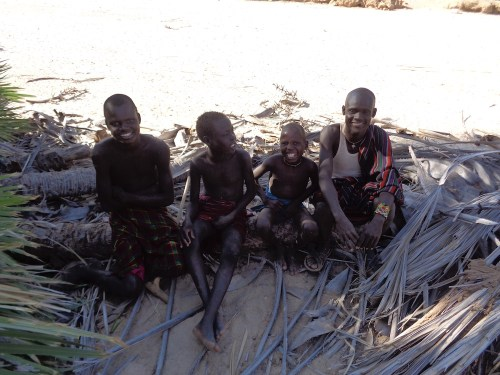 Local Turkana watch the students hard at work