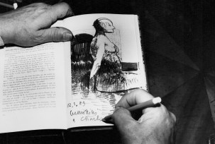 Leonardo Cremonini writing/drawing in the Ford guest book