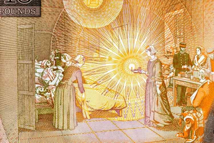 Florence Nighitngale in un dipinto che la ritrae in un ospedale