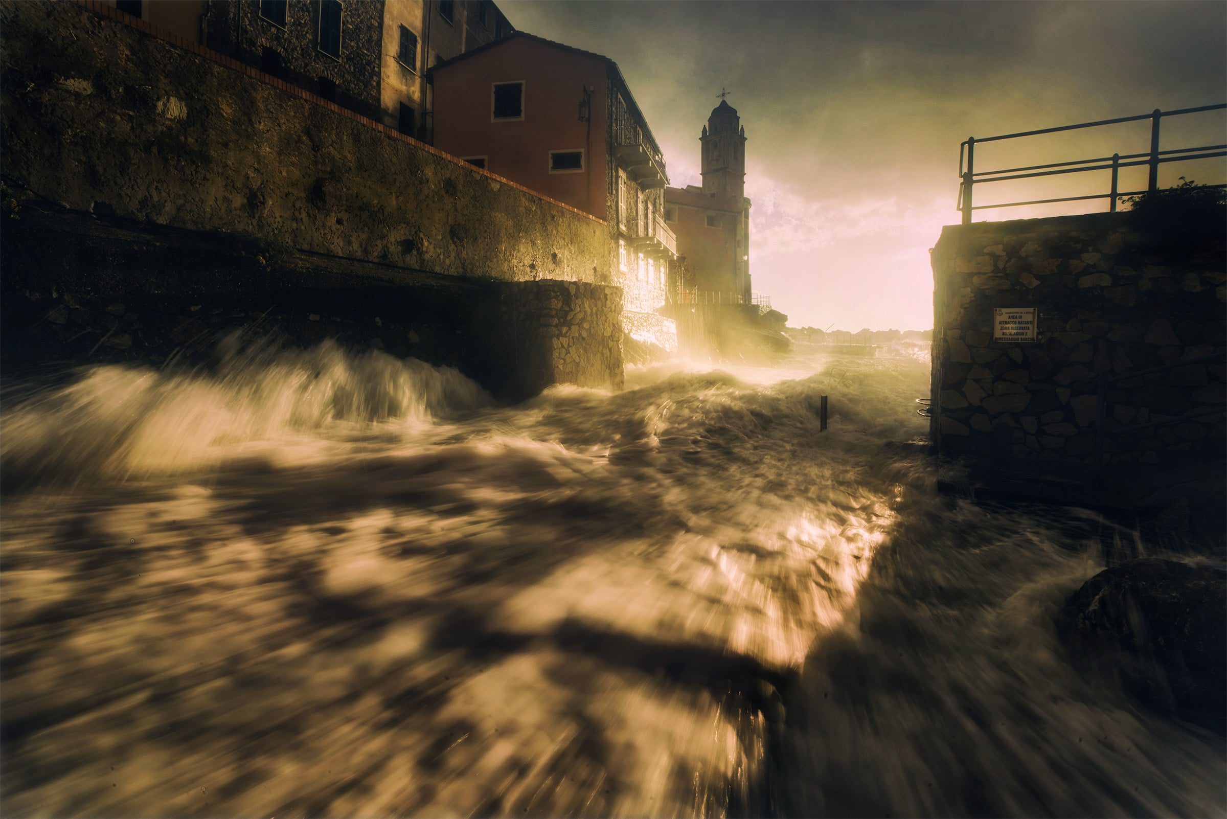 Tellaro with waves at golden hour