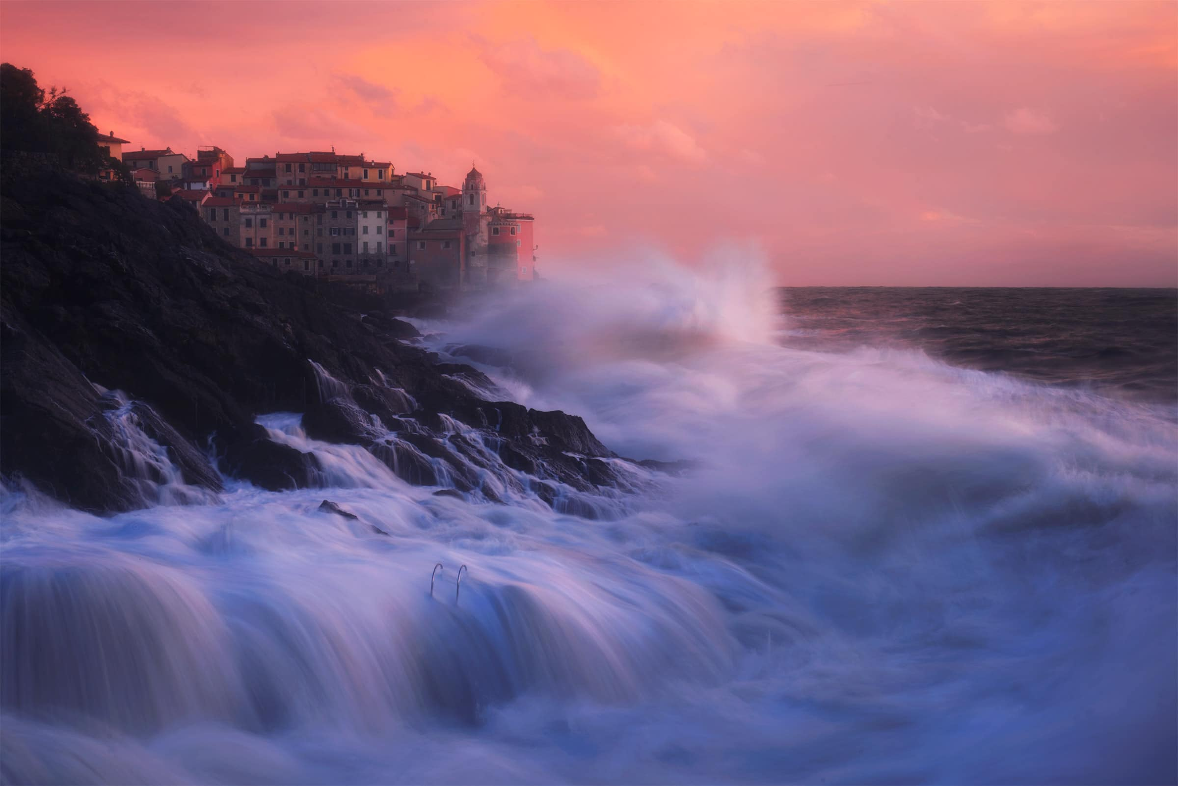 Tellaro during a sea storm at sunset