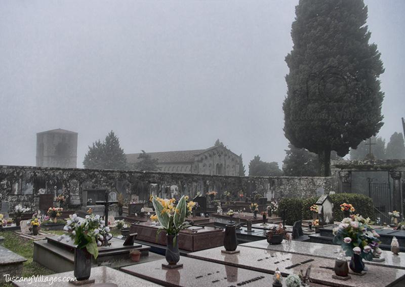 Castelvecchio Cemetery tomb stones, Il Pieve/Parish Church in the background