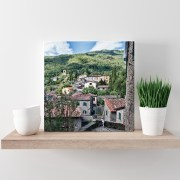 Canvas of Tuscany displayed on a shelf