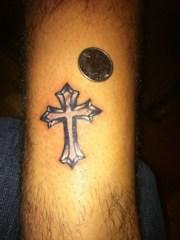 groovy cross tattoo design
