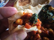 Chana masala cradled in a bit of naan