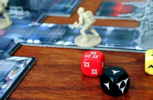 Imperial Assault bordspel met dobbelstenen en mini's