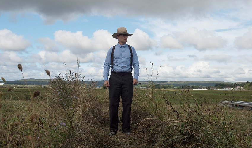 A man stands in a field.