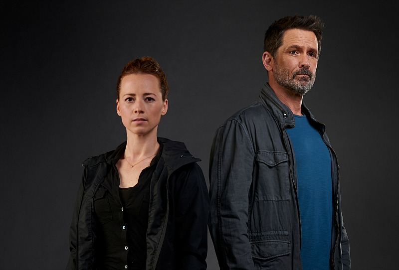 Karine Vanasse as Lise Delorme and Billy Campbell as John Cardinal