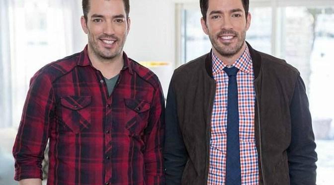 Two men smile into the camera.