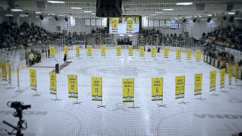 Banners sit on the ice in a hockey rink.