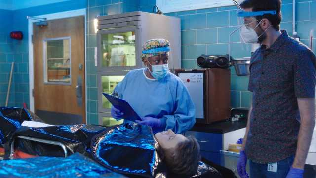 NCIS New Orleans Season 7 Episode 2 L-R CCH Pounder as Dr. Loretta Wade and Rob Kerkovich as Forensic Agent Sebastian Lund