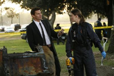 "BONES - David Boreanaz as FBI Special Agent Seeley Booth and Emily Deschanel as Dr. Temperance Brennan in ""The Boy in the Time Capsule"""