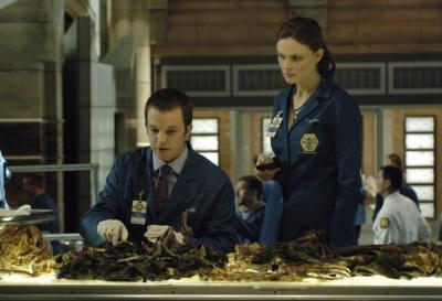 "BONES - Eric Millegan as Zack and Emily Deschanel as Dr. Temperance Brennan in ""The Boy in the Time Capsule"""