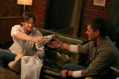 "SUPERNATURAL - Jared Padalecki as Sam Winchester and Jensen Ackles as Dean Winchester in ""A Very Supernatural Christmas"""