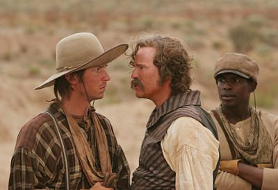 COMANCHE MOON - Troy Baker as Pea Eye Parker, Val Kilmer as Captain Inish Scull, and Keith Robinson as Joshua Deets on CBS