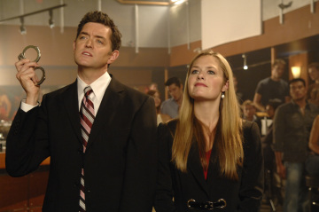 """PSYCH - Tim Omundson as Carlton Lassiter and Maggie Lawson as Juliet O'Hara in """"Black & Tan - A Crime of Fashion"""""""