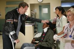 House (Hugh Laurie, L) and (Boogie, C)