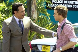 Jimmy Smits as Miguel Prado and Michael C. Hall as Dexter
