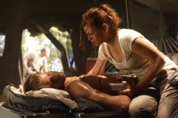 Smallville - Justin Hartley as Oliver Queen and Cassidy Freeman as Tess