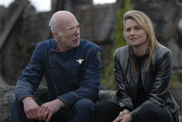 Michael Hogan as Col. Saul Tigh, Lucy Lawless as D'Anna Biers