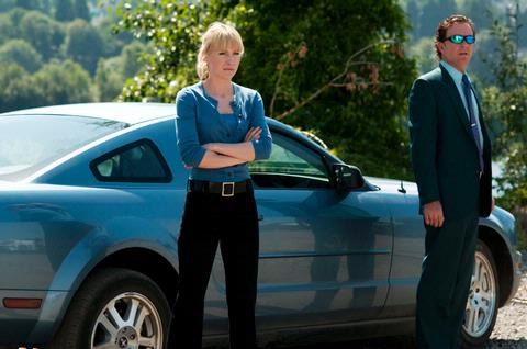 Beth Riesgraf and Timothy Hutton in Leverage