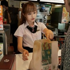 PAY-Woman-Hsu-Wei-han-working-at-the-front-counter-of-a-McDonalds-restaurant