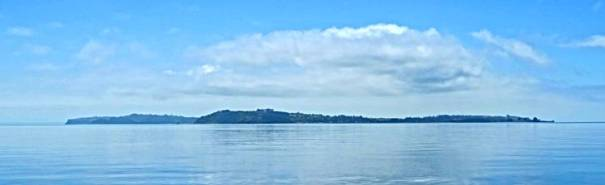 A distant island on a calm sea in Golfo Ancud