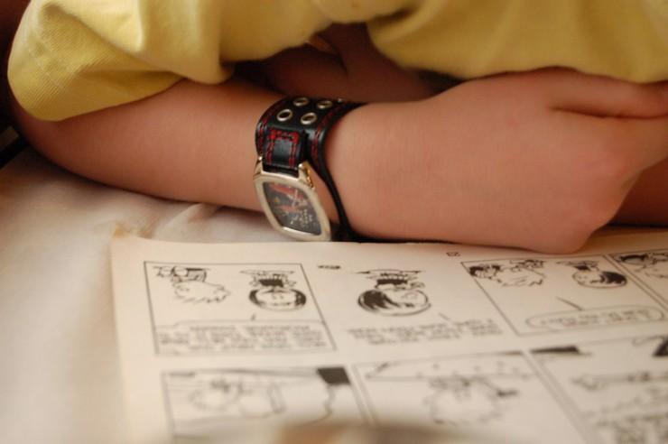 Top 10  Calvin & Hobbes Poems - boy reading Calvin & Hobbes comic