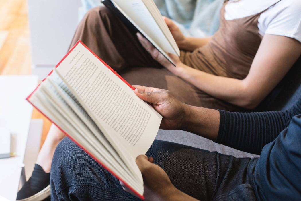 man-reading-book-beside-woman-reading-book-545068