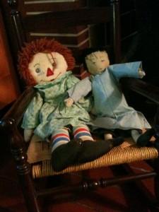 dolls in rocking chair