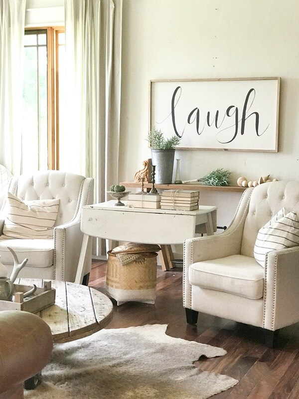 farmhouse living room chairs curtain ideas for modern the summer twelve on main decor complete with large signs pottery rustic wood